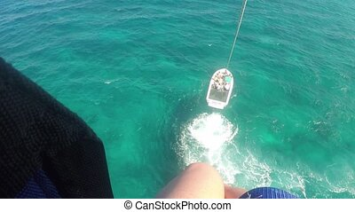 Aerial view parasailing over ocean