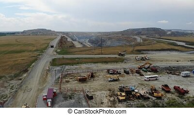 Aerial view parking of trucks. Industrial ore mining quarry, iron mining