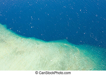 Aerial view part of the white island with crystal clear sea
