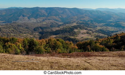 drone flies from left to right view on the mountain autumn season in the Carpathians