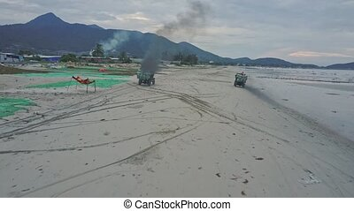 Aerial View Pickup Moves with Black Exhaust Smoke along Beach