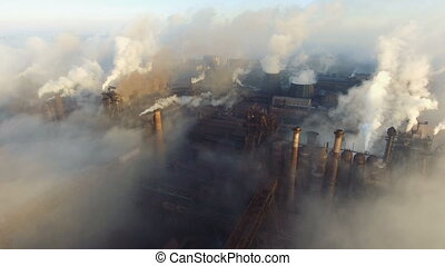 Aerial view. Pipes Throwing Smoke in the Sky. Large Plant on...