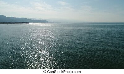 aerial view, retreat in of calm, blue sea