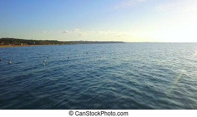 AERIAL VIEW. Rippled Sea Waters With Seagulls