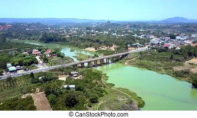 aerial view river bridge against green town - pictorial...