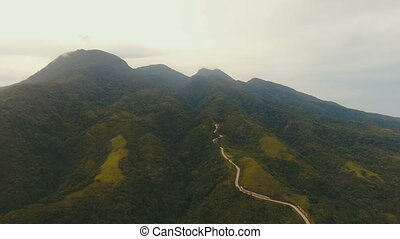 Aerial view road in the jungle mountains. Camiguin island Philippines.