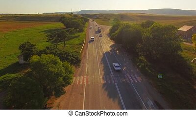 AERIAL VIEW. Road With Moving Cars At Fields