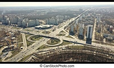 Aerial view roadway system in Kyiv, Odessa junction, with lots of cars on a sunny day. 1080p Full HD video