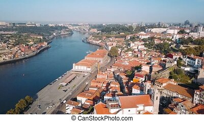Aerial view roofs of the Ribeira, Porto, Portugal. Flying over the old city center.