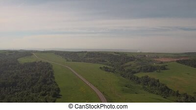 Aerial view. rural road among fields, countryside road...
