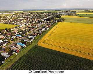 Aerial view rural town bordered by fields