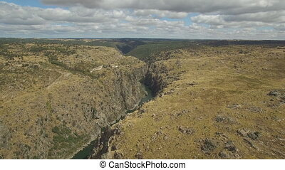Aerial view sliding camera to cliff in Duero River, Spain -...
