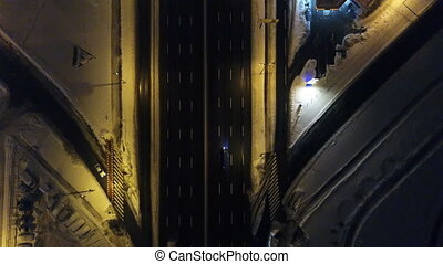 Aerial view snow-covered road with cars in winter at night