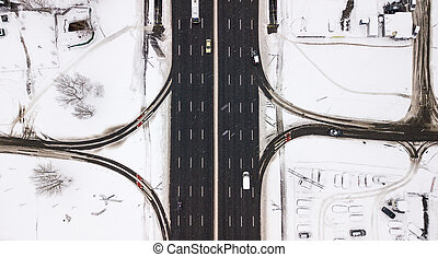 Aerial view snow-covered road with cars in winter