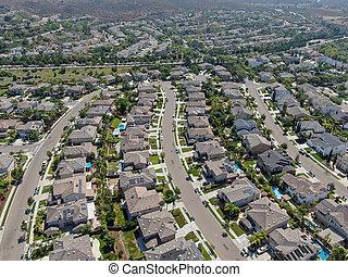Aerial view suburban neighborhood with big villas