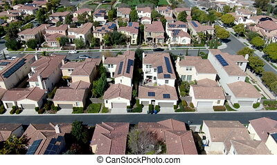 Aerial view suburban neighborhood with identical villas next to each other. San Diego, California