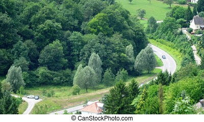 Aerial view suburban road - Aerial view from hill on...