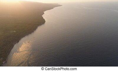 coastline during sunset - aerial view sunset sunbeam on sea...