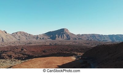 Aerial view - Teide National Park, desert, frozen lava and high mountains, the foot of the volcano