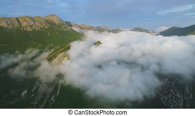 aerial view the mountain shrouded in clouds
