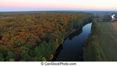 Aerial view the river on green forest plain. Taiga, autumn