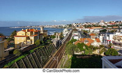 Time-lapse in Estoril with trains, clouds and traffic