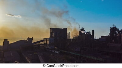 Aerial view. Timelapse. Smoke from the factory pipes. Ecology is under threat
