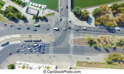 Aerial view to city crossroads with cars and river, Kharkiv...