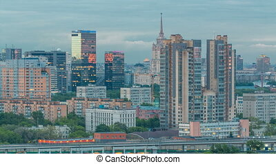 Aerial view to cityscape skyline with World Trade Center towers and hotel Ukraine day to night timelapse in Moscow, Russia.