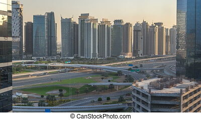 Aerial view to JLT and Dubai Marina with big highway...