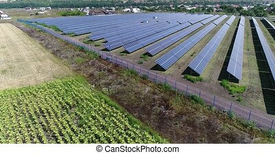 Aerial view to solar power plant. Industrial background on renewable resources theme. flying over rows of solar panels, solar panels, solar panels on the field, top view, View from above, 4K