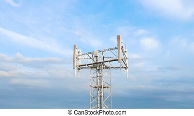 Aerial view to telecommunication tower with antennas for mobile internet network on blue sky background. 5g broadcast. High quality 4k footage