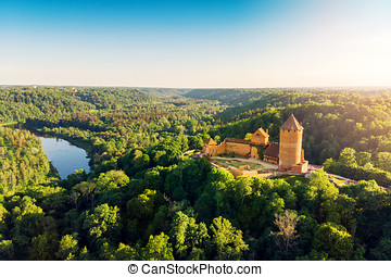 aerial view to the Turaida castle and river Gauja at sunset,...
