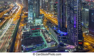 Aerial view to traffic on Sheikh Zayed road and skyscrapers...