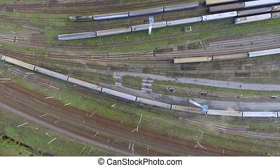 Aerial view. Trains moving out from platform of railway station
