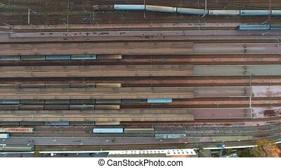 Aerial view. Trains moving out from platform of railway...