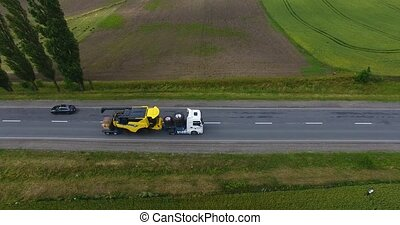 Aerial view. Transportation of combines on road tractors on ...