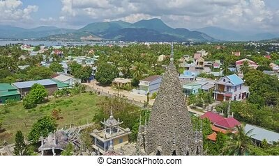 Aerial View Tropical City with Old Coral Buddhist Temple