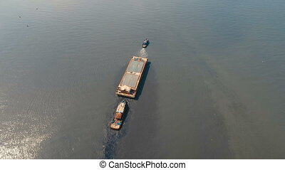 Aerial view tugboat and barge in the sea.Philippines, Manila.