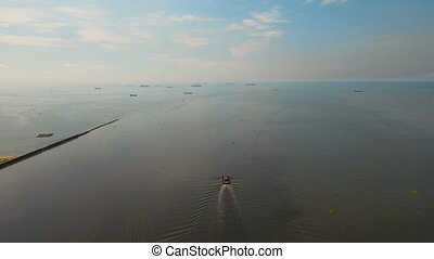 Aerial view tugboat in the sea.Philippines, Manila. - Aerial...
