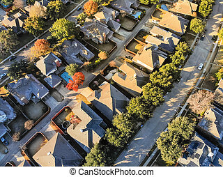 Aerial view typical house with light snow covered roof in cold fall morning