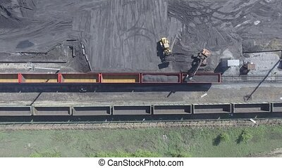Aerial view UHD 4K of freight train with wagons and standing...