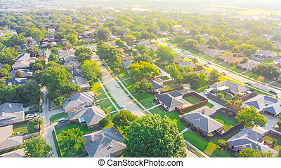 Aerial view urban sprawl subdivision near Dallas, Texas, USA row of single family homes large fenced backyard