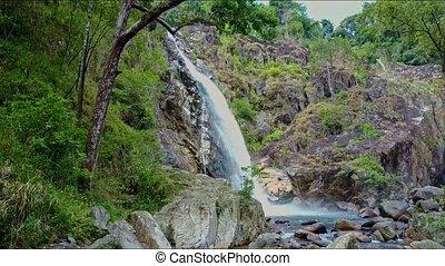 Aerial View Waterfall Runs into Beautiful Lake among Rocks