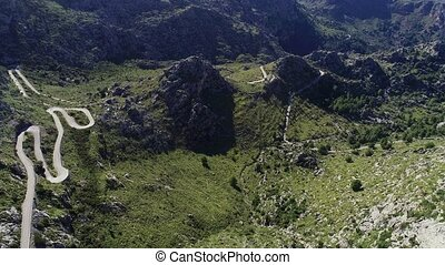 aerial view winding serpentine road at Mallorca isle - ...