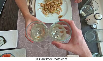 aerial view wine cheers - SLOW MOTION: Aerial view of two...