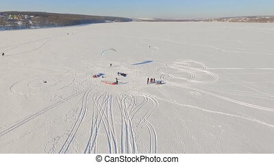 aerial view. Winter vacation on the frozen lake. horseback riding