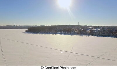 aerial view. Winter vacation on the frozen lake. Snowmobile,