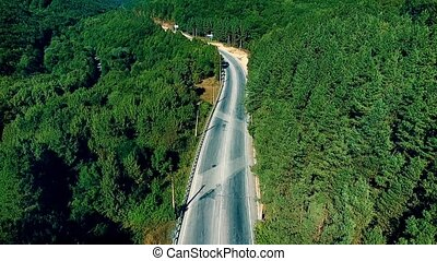 Aerial view with the forest, highway, cars, trucks in a mountains