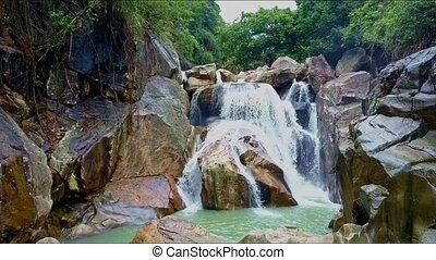 Aerial View Woderful Waterfall among Rocks against Jungle